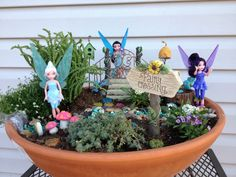 This is my fairy garden. Creating it was really fun. It contains Disney fairies rather than ceramic.