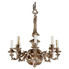 Silver over bronze chandelier | From a unique collection of antique and modern chandeliers and pendants at https://www.1stdibs.com/furniture/lighting/chandeliers-pendant-lights/
