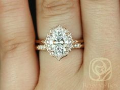 Mae 9x7mm & Stella 14kt Rose Gold Oval F1 Moissanite and