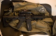 DPMS Forged Lower         LMT Upper & Bolt Carrier Group         Troy BUIS (Back Up Iron Sights)         Rock River Arms 2-Stage Lower Parts Kit         Larue Tactical 7.0 Handguard         Larue Tactical LT100 Mount         Trijicon ACOG TA31RCOM4         Hogue AR-15 Grip         Magpul CTR         Magpul AFG