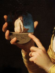 """Gerrit van Honthorst, Smiling Girl (Courtesan) Holding an Obscene Image, 1625, detail The inscription reads: """"Who can tell my backside from behind?"""""""