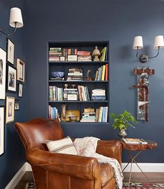 Domino shares unique spare room ideas for your home. Find spare room ideas for your home including an exercise room, home bar, or large closet. Warm Paint Colors, Modern Paint Colors, Cozy Reading Corners, Reading Nooks, Reading At Home, Book Nooks, Leather Club Chairs, Brown Leather Armchair, Leather Sofa