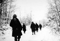 Battle of the Bulge – three Medal of Honor heroes. American soldiers of the 84th Infantry Division are shown moving up to new positions through the snow covered countryside in Belgium. Co. I, 333rd Infantry regiment 1/5/45