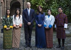 April 6, 2016, Prince William and his wife The Duchess of Cambridge attended a reception with young people from India and Bhutan at Kensington Palace before the India and Bhutan royal visit. (The Duchess wore a full-length piece by Indian designer Saloni. The Duchess wore a bespoke version of the Mary Illusion Dot Dress, the navy dress features an illusion plunging neckline with a high ruffled neck, long sleeves and a floor-length column silhouette.