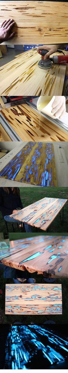 Светящийся стол. Люминесцентная краска заливается в щели. Поверх наносится смола или эпоксидка. Шлифуется, полируется.