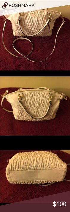 White adorable Coach bag Great bag! Has been preloved but still in great condition. Small stain by zip ... Comes with side strap ... any questions please ask! Coach Bags Satchels