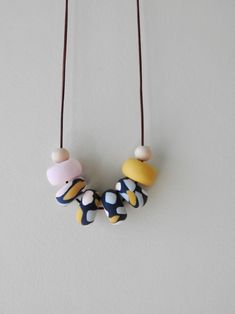 Necklace, Polymer Clay Necklace, Navy beads, Pale pink beads, Mustard yellow beads, Grey beads, Wooden beads, Leather cord, Adjustable cord