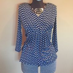 Cute slim waist top royal blue or free w/$10 &  Cute waist slimming top in royal blue white and black design great wrinkle free stretch fabric sz m by Daisy Fuentes in excellent gently pre owned condition $4 or get it free with a $10 & up purchase from my closet! Daisy Fuentes Tops Blouses