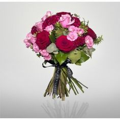Find the sweet side of love with this beautiful arrangement of red Naomi roses, deep water roses, spray roses and celosia