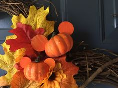 DIY Fall Mickey Wreath. This is happening. LOVE the added touch of the Mickey pumpkins too.