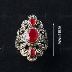 http://gemdivine.com/antique-gold-rings-for-women-vintage-fine-jewelry-black-red-resin-stone-strass-bohemian-turkish-ring-female-ethnic-punk-fashion/