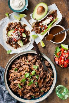 Incredibly moist Mexican Shredded Beef in a thick rich sauce. Make this in the slow cooker, oven or stovetop. Use for tacos, burritos, enchiladas and more!