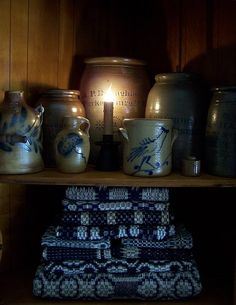 Cupboard...filled with salt glazed stoneware crocks and coverlets.