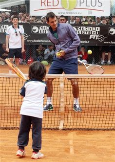 Roger Federer playing with a little kid!  cute!