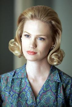 January Jones as Betty Draper looked early '60s chic with a flipped out blond bob and peachy lipstick.
