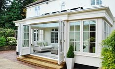 kitchen extensions An orangery differs from a conservatory in that it classifies as an extension of your home, not an addition. I searched for this on Garden Room Extensions, House Extensions, Kitchen Extensions, Orangerie Extension, Orangery Extension Kitchen, Kitchen Orangery, Orangery Conservatory, Conservatory Ideas, 4 Season Room