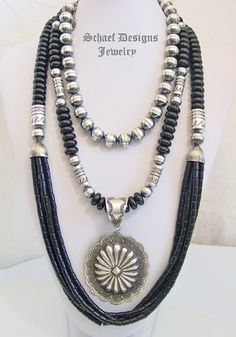 Layers of black onyx & sterling silver bench bead necklaces with Vince Platero Concho pendant