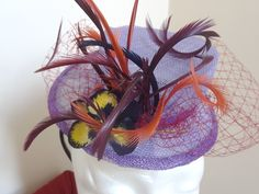 Cold Porcelain Pansy on home made sinamay fascinator.