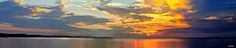 Cold Gold Sunset Over Tampa Bay - Even though most sunsets I get to see my blessed home are ofter fiery red and gold, hot orange and hotter pink, even on a cold week in January, with the bay water tranquil like a lake, the cold golden lights of the sunset lighting the clouds into the sky and reflecting on the water right to my feet, the magic is visibe and palpable.