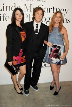 """Mary, Paul & Stella McCartney.  LONDON, ENGLAND – JUNE 06, 2011: Paul McCartney, his family & friends, attend a private view of the book launch of """"Linda McCartney: Life In Photographs"""" at Phillips de Pury And Company on June 6, 2011 in London, England."""