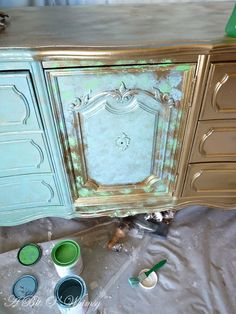SO COOL - zoom in on the picture! Spray painted gold, dabbed with Provence and Antibes Green Annie Sloan Chalk Paint, one layer of watered down Old White, waxed, and then distressed.
