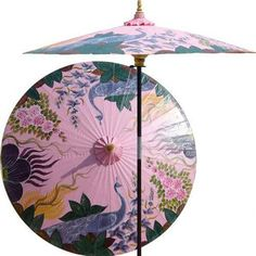 Peacock Garden (Pristine Pink) asian outdoor umbrellas | two peacocks in an Asian garden | Peacocks are symbolic of wholeness, dignity and pride in Oriental lore. Bring any outdoor setting to life with this fabulous pink patio umbrella. - 7 foot umbrella pole constructed of rich stained oak hardwood. - Each umbrella is entirely handcrafted down to the finest detail. - Oil-treated cotton umbrella shades are all hand-painted by our master artists. - Dual position shade height allows for full…