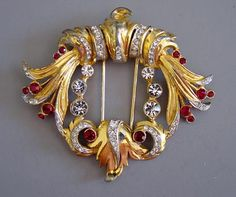 "DeROSA gold tone with red and clear rhinestone fur clip, 2-1/3""."