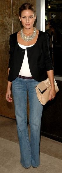 Wide legged jeans, beautiful but simple jacket, bold necklace, clutch. Olivia Palermo puts a great look together.