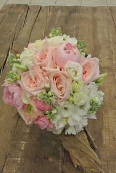 Pink and white bridal bouquet with garden roses, peonies, lisianthus, ranunculus and stocks. Designed by Forget-Me-Not Flowers in Banff.