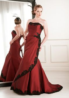 Red wedding gown with black trim, too pretty.