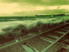 Portballintrae  beach and Giants Causeway railway in Northern Ireland