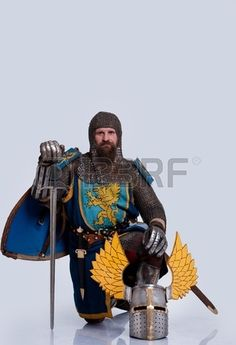 Medieval knight standing on his knee  Stock Photo