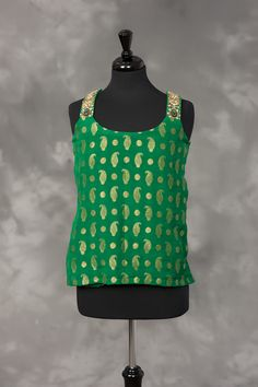 Green and gold woven silk with metallic gold embroidery.