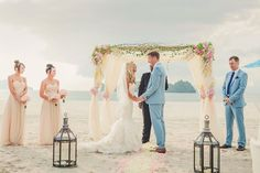 Romantic Destination Wedding in Malaysia...love the big lanterns and simple arch. The blue suits look awesome!