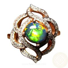 Fancy Black Opal Ring with many Diamonds in 14k Gold.  Neon Color in the almost round Opal  with 70 diamonds adding sparkle. http://www.flashopal.com/Black-Opal-Ring-Diamonds-Gold-Neon-Gem/