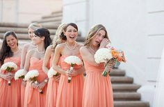 Simple salmon strapless dresses with all white bouquets and strands of pearls