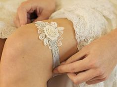 An embroidered floral applique set delicately against vintage-inspired lace is the centerpiece of this bridal garter. The soft elastic ribbon feels