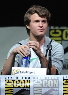 Ansel Elgort Photos - Actor Ansel Elgort speaks onstage at the 'Enders Game' and 'Divergent' panels during Comic-Con International 2013 at San Diego Convention Center on July 18, 2013 in San Diego, California. - Comic-Con Panels for 'Ender's Game' and 'Divergent'