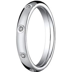 White gold ring with bezel-set diamonds by Benchmark.