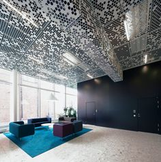Crazy metal perforated ceiling spotted in the Flat Iron Building by Rosenbergs Arkitekter