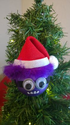 Hey, I found this really awesome Etsy listing at https://www.etsy.com/listing/213448334/santa-purple-minion-ornament
