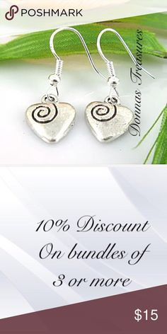 """❄️Silver Heart Earrings These earrings are made of sterling silver hooks (no stamp) & nickel free alloy for the hearts. The measurements are: 1.25"""" from top to bottom & .50"""" at the widest part of the charm. They feature a black etched swirl at the top of the heart. A very sweet look! Jewelry Earrings"""