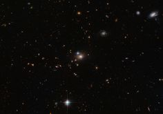 """01-28-2014: """"Hubble's Double Take"""": The Hubble Space Telescope (HST) """"Sees"""" a Distant Quasar, QSO 0957+561, as a """"Double"""" Due to the Phenomenon of Gravitational Lensing Caused by an Intervening Galaxy, YGKOW G1, in Our Line of SIght"""