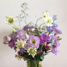 floral arrangement by Greenery NYC of wild flowers #flowers #wildflowers #lisianthus #scabiosa #delphinium #sweetpea #wild #beautiful