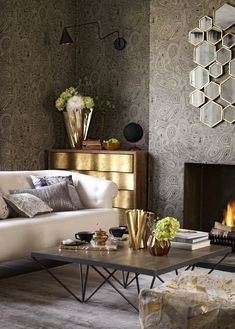 Introduce burnished golden accessories to highlight walls papered in a mineral patterned wallpaper. Bring in touches of silver for a luxurious contrast. For more living room ideas visit housebeautiful.co.uk