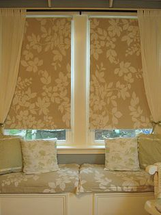 Fabric Covered  Roller Shades with Matching Fabric on Window Seat