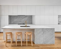 A large, marble island is the focal point of the all-white kitchen. Home Design, Interior Design, Patio Interior, Interior Exterior, All White Kitchen, Kitchen And Bath, Layout Design, Design Ideas, Ideas Cafe