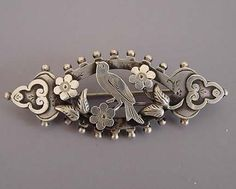 VICTORIAN sterling silver hallmarked 1894 bird brooch with floral and leaf…