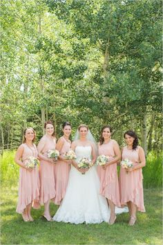 pink ruffled bridesmaids dresses #bridesmaids #pinkdresses #weddingchicks http://www.weddingchicks.com/2014/03/03/majestic-alberta-mountain-wedding/