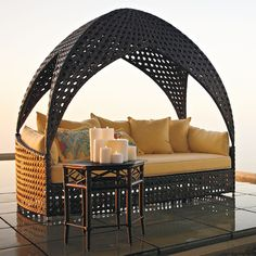Bali Daybed - Curl up comfortably and escape to the inner sanctum of our Bali Daybed. Cooling breezes flit in and out of the uniquely woven hideaway with cathedral-domed canopy. Both top and daybed are meticulously woven by hand with wide strands of espresso fibers. The thick, Sunbrella® cushioned seat is deep and wide enough to stretch out and fall asleep, with side lumbars and five throw pillows ensuring your comfort.